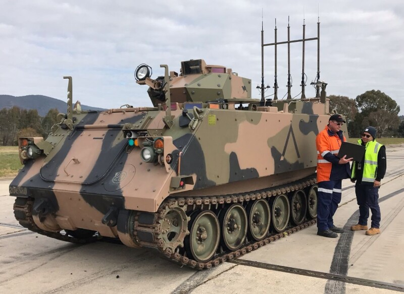 jeff berg acubis in front defence armoured tank